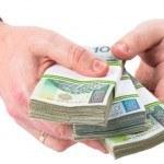dużo pieniędzy w męskich dłoniach